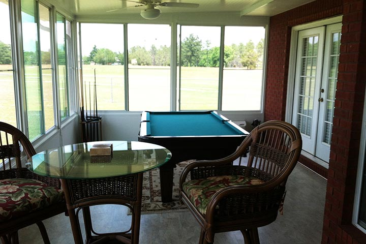 Sunroom that effectively extended the house includins air conditioning, a pool table and enough space for chairs, recliners and even a little bar. Built in Mississipi, MS