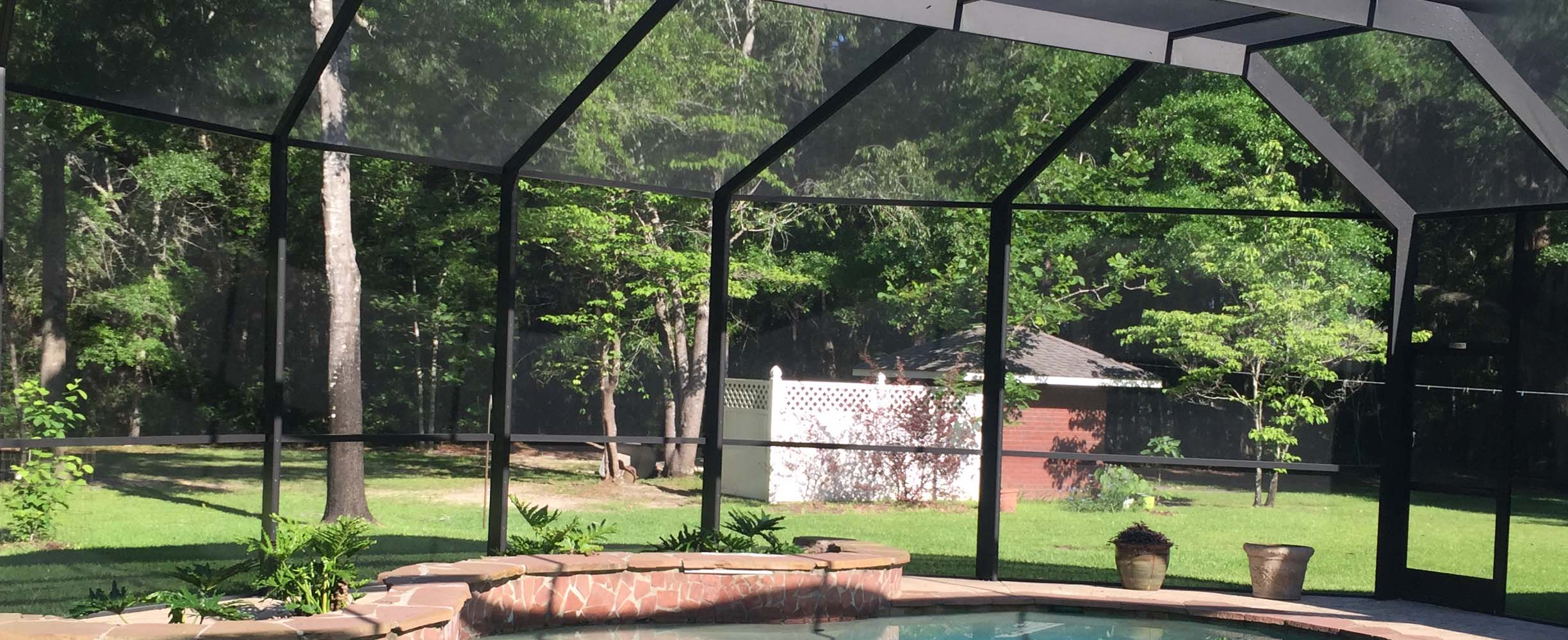 Pool Enclosure With Black Aluninum And Modern Materials And Structure That  Stands Typical Southern High Winds