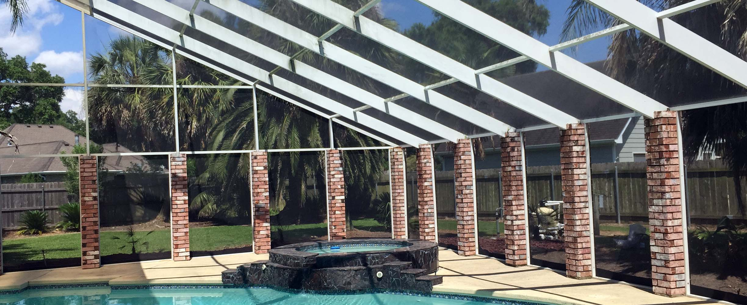 Pool enclosure with aluminum, plastic and glass