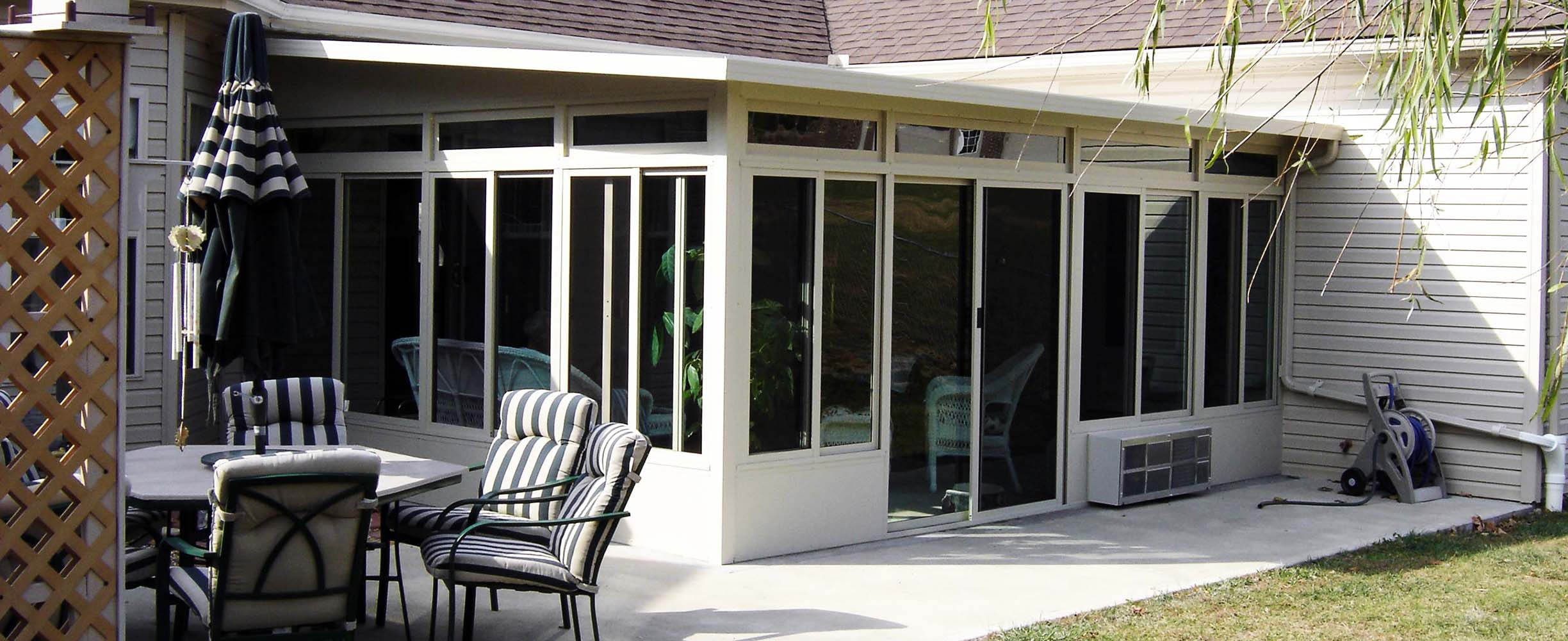Sunroom designed and implemented for all seasons effectively expanding the house in a practical and cofortable way!